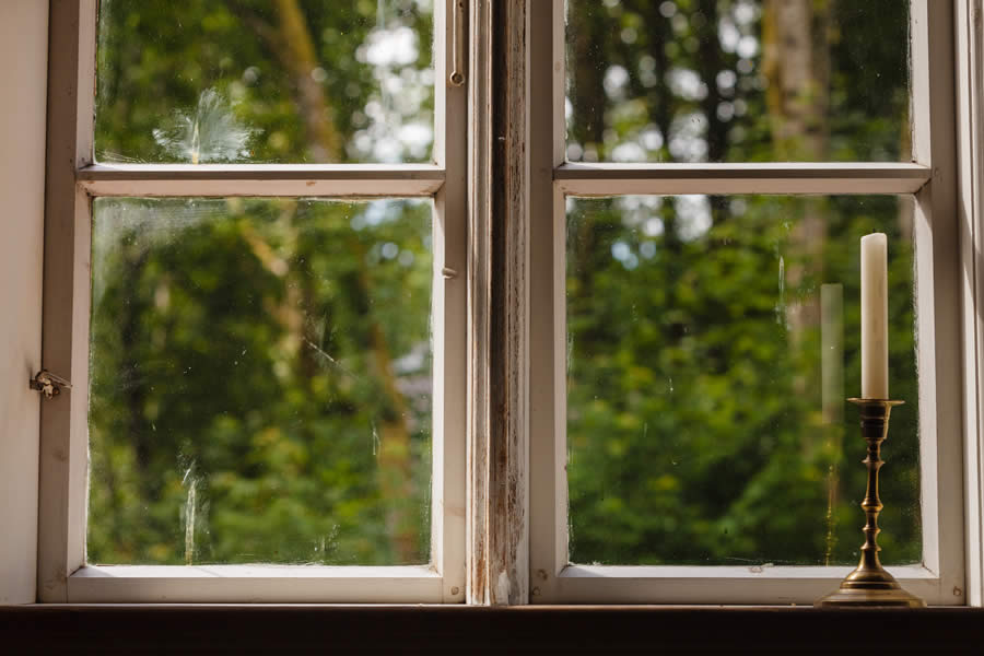 Tips to Properly Maintain Wooden Windows in Michigan