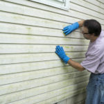 Contractor Inspecting Siding in Grosse Ile Michigan